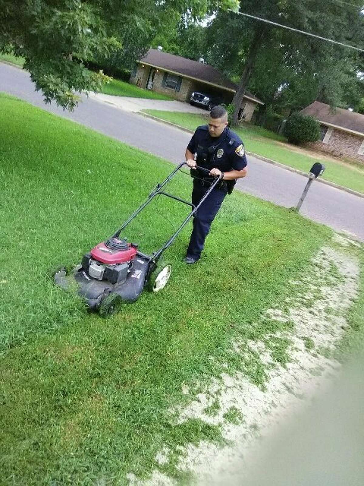 """Longview police officers Ron Duncan and Officer Michael Preston mowed disabled veteran Robert Upshaw's lawn on July 4, 2017. Keep clicking to see which Texas heroes were nominated to the """"beloved veterans"""" list."""