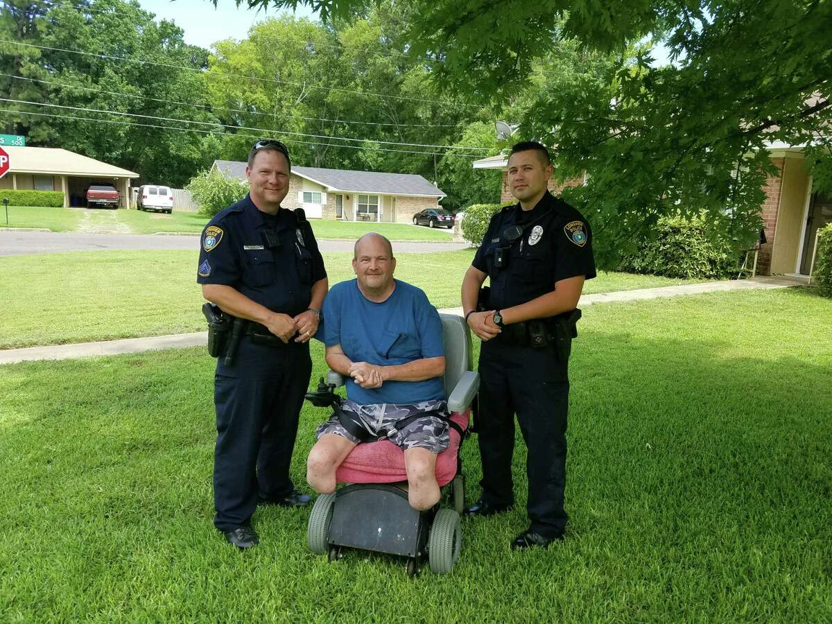Longview police officers Ron Duncan and Officer Michael Preston mowed disabled veteran Robert Upshaw's lawn on July 4, 2017.