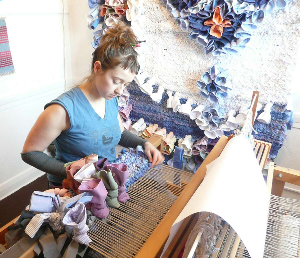 Angie Wilson at work. She's one of the 30 artists represented in