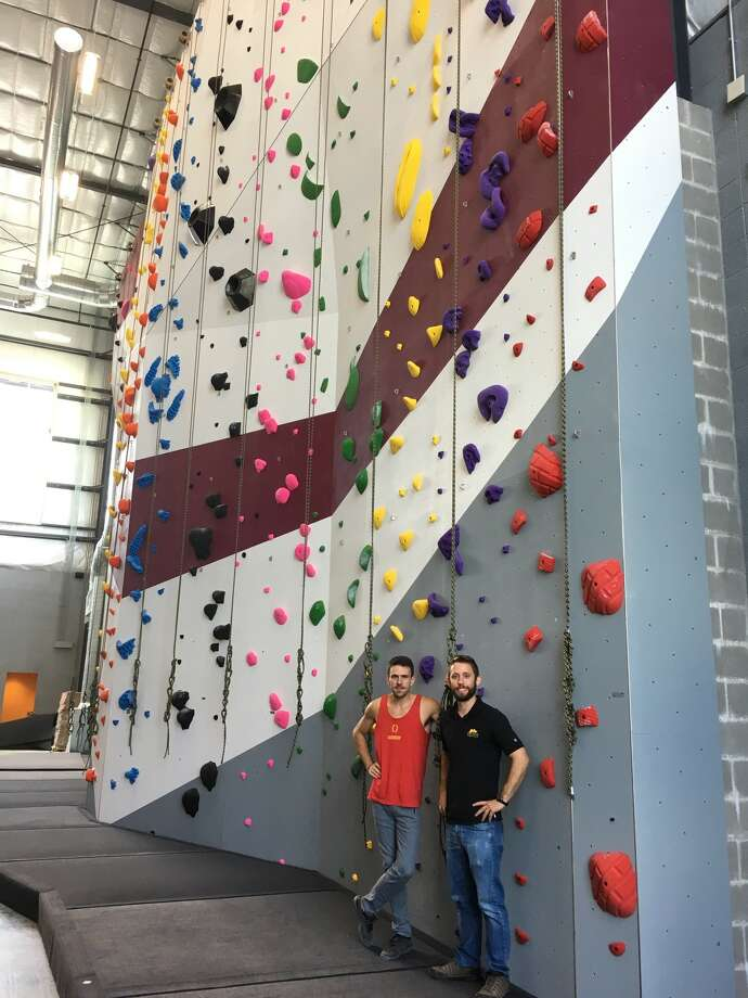 Helping to prepare Momentum Indoor Climbing Katy for its July opening are, from left, John Oungst, the facility's regional route setter, and Rees Williams, the facility's general manager. Photo: Karen Zurawski