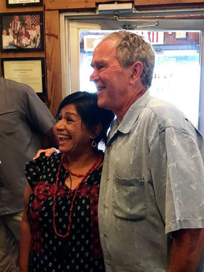 President Bush and former first lady, Laura Bush, chatted with the guests of Coffee Shop Cafe in McGregor following a surprise visit.
