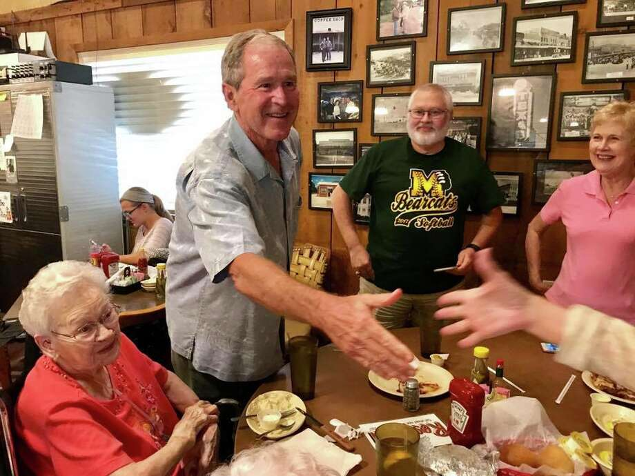 President Bush and former first lady, Laura Bush, chatted with the guests of Coffee Shop Cafe in McGregor following a surprise visit. Photo: Photo: Valerie Duty Citrano