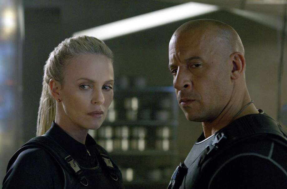 "Dom (Vin Diesel) with homicidal homewrecker Ciper (Charlize Theron) in ""The Fate of the Furious."" Photo: Universal Pictures / Copyright: © 2017 Universal Studios. ALL RIGHTS RESERVED."