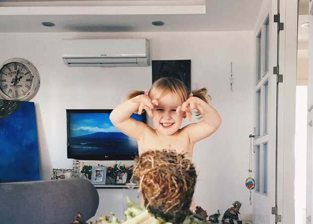 Mom 'dresses' daughter with adorable optical illusions using food, flowers