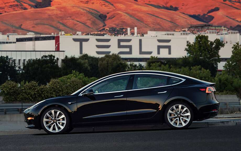 This image provided by Tesla Motors shows the Tesla Model 3 sedan. Electric automaker Tesla has produced its first Model 3 sedan, a highly anticipated car because it carries a relatively low sticker price. On Saturday, July 8, 2017, CEO Elon Musk tweeted pictures of the car, which will cost $35,000 and can travel 215 miles on a single electric charge. A $7,500 federal tax credit for electric vehicles would lower the cost to $27,500. (Courtesy of Tesla Motors via AP) Photo: Associated Press
