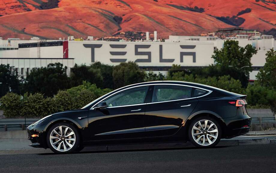 This image provided by Tesla Motors shows the Tesla Model 3 sedan. Electric automaker Tesla has produced its first Model 3 sedan, a highly anticipated car because it carries a relatively low sticker price. On July 8, CEO Elon Musk tweeted pictures of the car, which will cost $35,000 and can travel 215 miles on a single electric charge. A $7,500 federal tax credit for electric vehicles would lower the cost to $27,500. Photo: Courtesy Tesla Motors / Tesla Motors