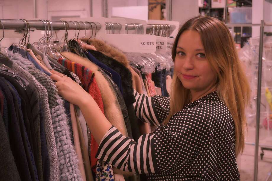 Dana Covarrubias, San Antonio native and Churchill High grad, has served as head costume designer for lots of TV hits. Here, she looks over some wardrobe choices. Photo: Courtesy Dana Covarrubias