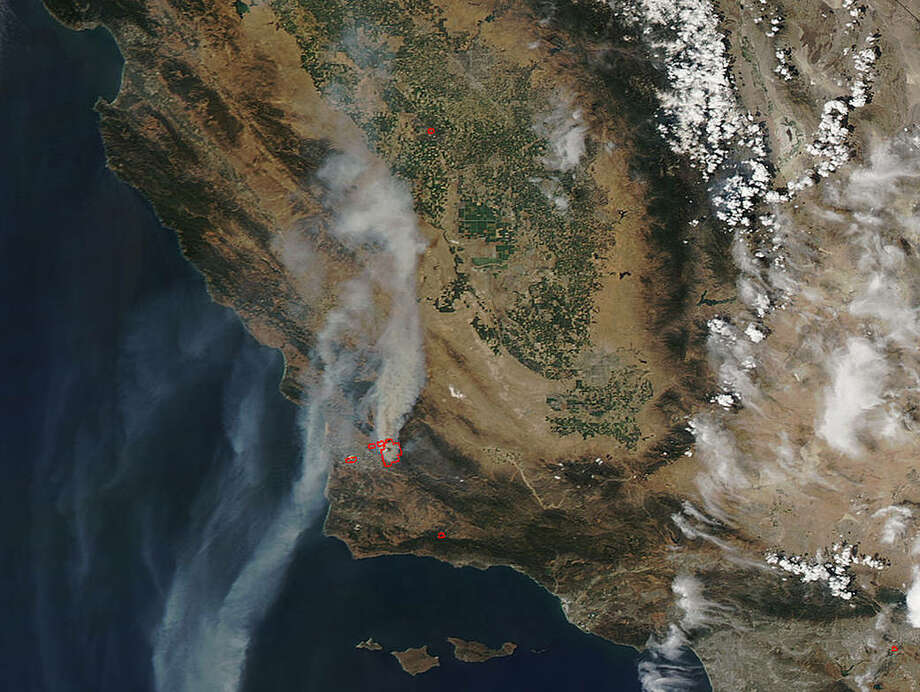 NASA satellite images show smoke spewing from a wildfire in Santa Barbara County on June 9, 2017. Photo: NASA