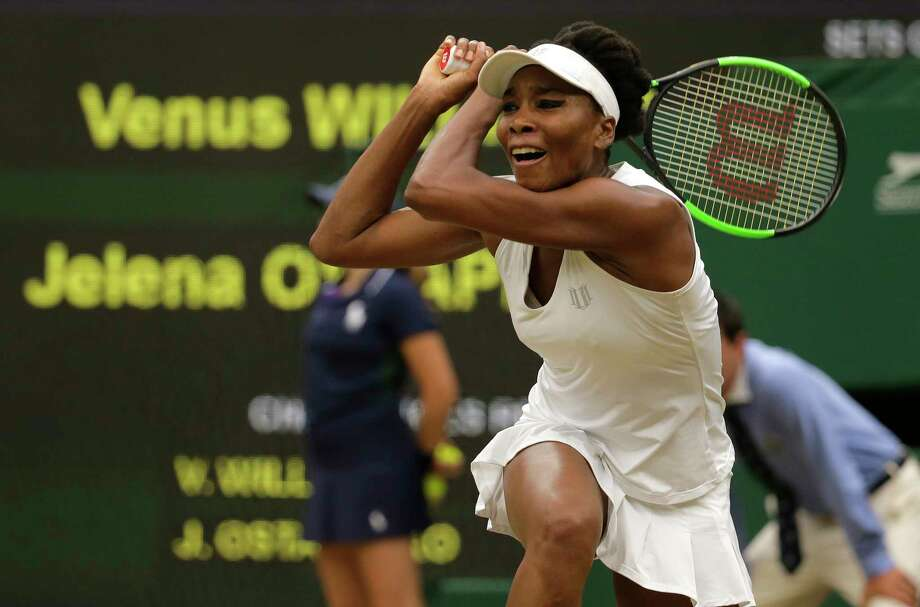 Venus Williams of the United States returns to Latvia's Jelena Ostapenko during their Women's Quarterfinal Singles Match on day eight at the Wimbledon Tennis Championships in London Tuesday, July 11, 2017. (AP Photo/Alastair Grant) Photo: Alastair Grant, STF / Copyright 2017 The Associated Press. All rights reserved.