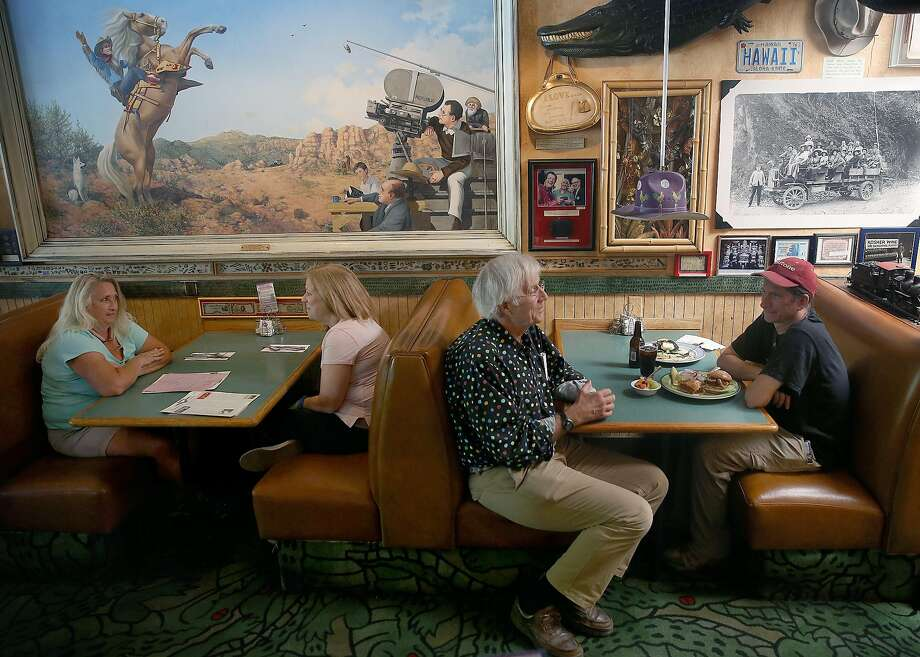 Owner Jamis MacNiven (middle) chats with customer James Worthington at Buck's. Photo: Liz Hafalia, The Chronicle