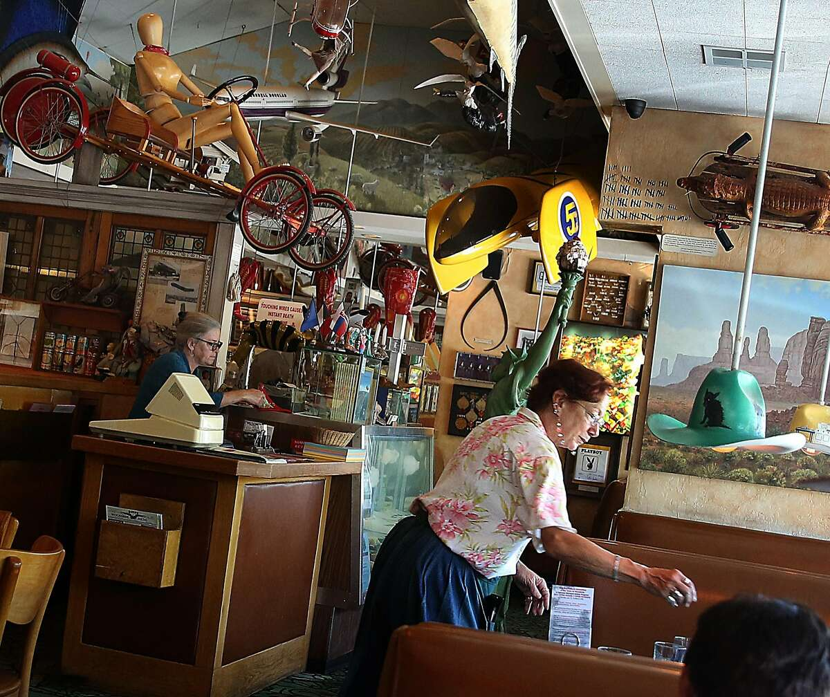 Nadine Sady (right) clears a table at Buck's on Wednesday, July 5, 2017, in Woodside, Calif. She has been with the restaurant since it's opening 26 years ago.