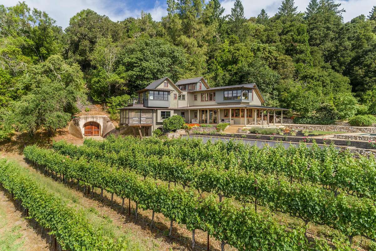 More than 4 acres of cabernet vineyard stretches beside the Napa home.�