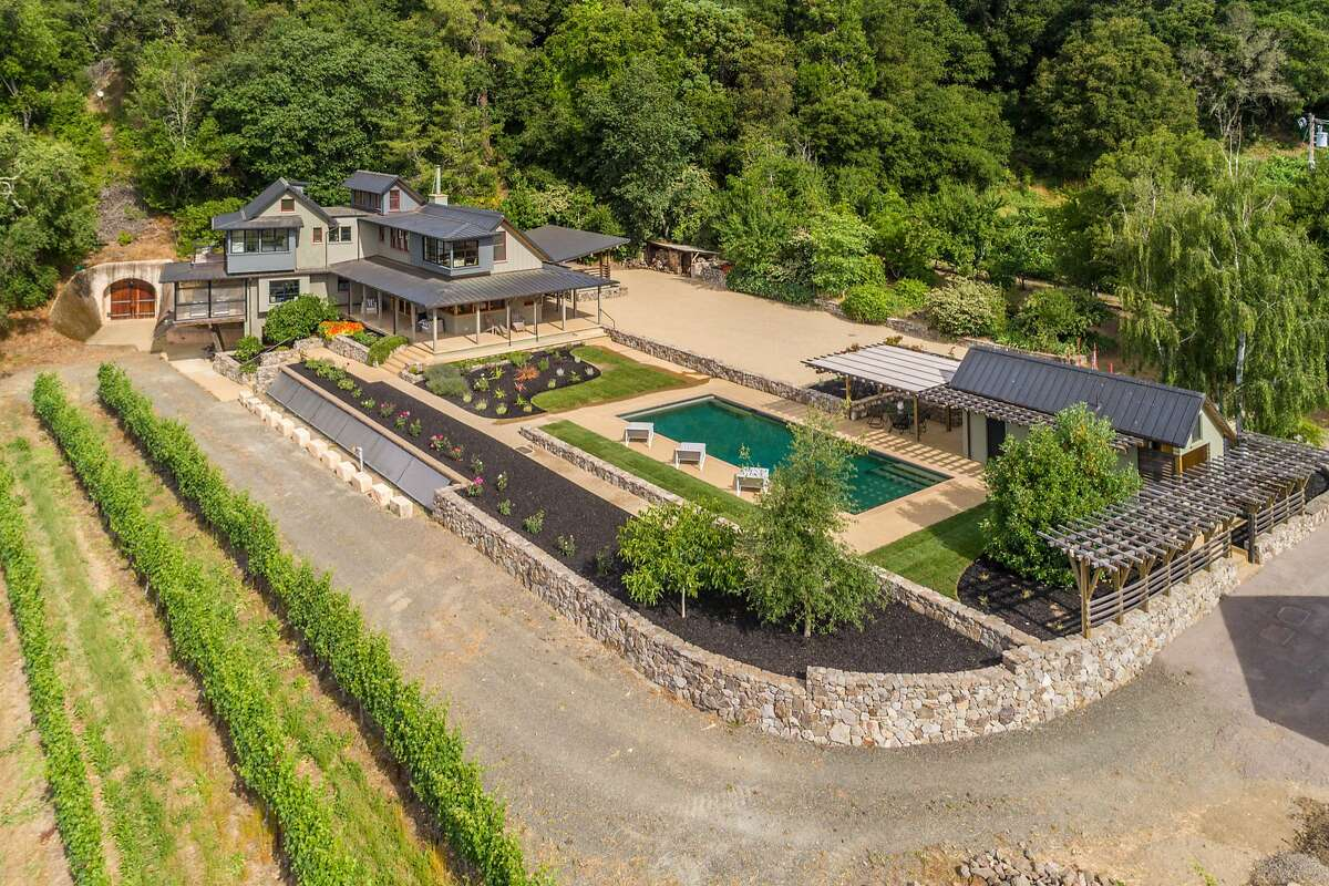 This aerial shot showcases the home�s vineyard, pool and detached pool house.�
