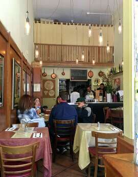 L'Osteria del Forno, left, has prospered in North Beach.