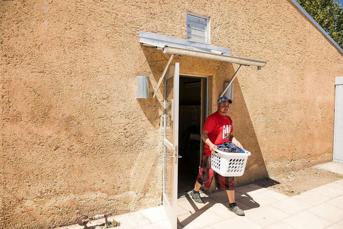 Cesar Alegria Ruiz finishes a load of laundry at the River Ranch Farm Workers Housing in St. Helena, Calif. on Thursday, July 6, 2017.