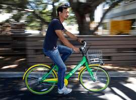 Brad Bao, co-founder and chairman of Lime Bike, takes a spin on a bicycle in San Mateo, Calif. on Tuesday, July 11, 2017. Lime Bike hopes to deploy as many as 3,000 of its undocked and station-less bike-share bicycles on the streets of San Francisco as soon as the permitting process is completed.