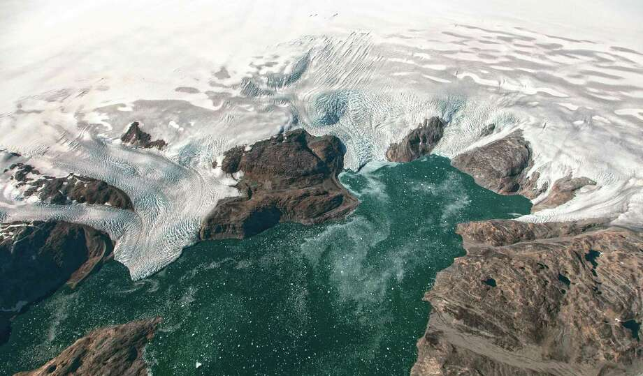 Oceans rose 50 percent faster in 2014 than 1993, with the Greenland Ice Sheet's share of total sea level rise jumping from five to 25 percent over the same period, researchers reported on June 26, 2017. Photo: JEREMY HARBECK, AFP/Getty Images / AFP