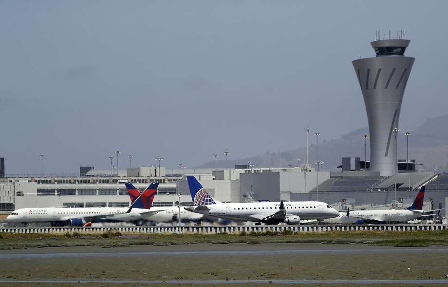 "Departing and parked aircraft intersect at San Francisco International Airport, Tuesday, July 11, 2017, in San Francisco. An Air Canada Airbus A320 was cleared to land on one of the runways at the San Francisco airport just before midnight on Friday, July 7, when the pilot ""inadvertently"" lined up with the taxiway, which runs parallel to the runway. There were other aircraft lined up on the taxiway waiting for departure when the incident occurred. Photo: Marcio Jose Sanchez, Associated Press"