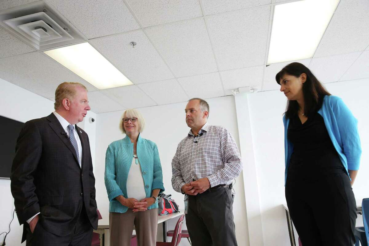 Mayor Ed Murray (left), Seattle city councilmember Sally Bagshaw (center-left), director of the Downtown Emergency Services Center Daniel Malone (center-right) and state Rep. Nicole Macri D-Seattle tour the new Navigation Center, Tuesday, July 11, 2017. Following in San Francisco's footsteps, this week Seattle opens it's first Navigation Center, an innovative homeless shelter that will allow couples to stay together, guest to have pets, store their belongings and have access to 24-hour services. The shelter will also be low-barrier, meaning that residents are not required to maintain sobriety.
