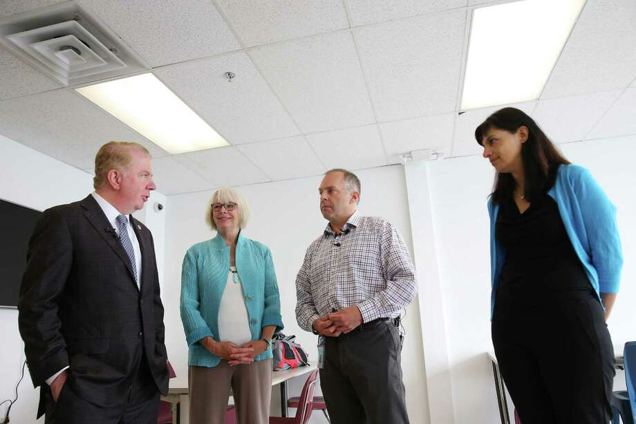 Mayor Ed Murray (left), Seattle city councilmember Sally Bagshaw (center-left), director of the Downtown Emergency Services Center Daniel Malone (center-right) and state Rep. Nicole Macri D-Seattle tour the new Navigation Center, Tuesday, July 11, 2017. Following in San Francisco's footsteps, this week Seattle opens it's first Navigation Center, an innovative homeless shelter that will allow couples to stay together, guest to have pets, store their belongings and have access to 24-hour services.  The shelter will also be low-barrier, meaning that residents are not required to maintain sobriety. Photo: GENNA MARTIN, SEATTLEPI.COM / SEATTLEPI.COM