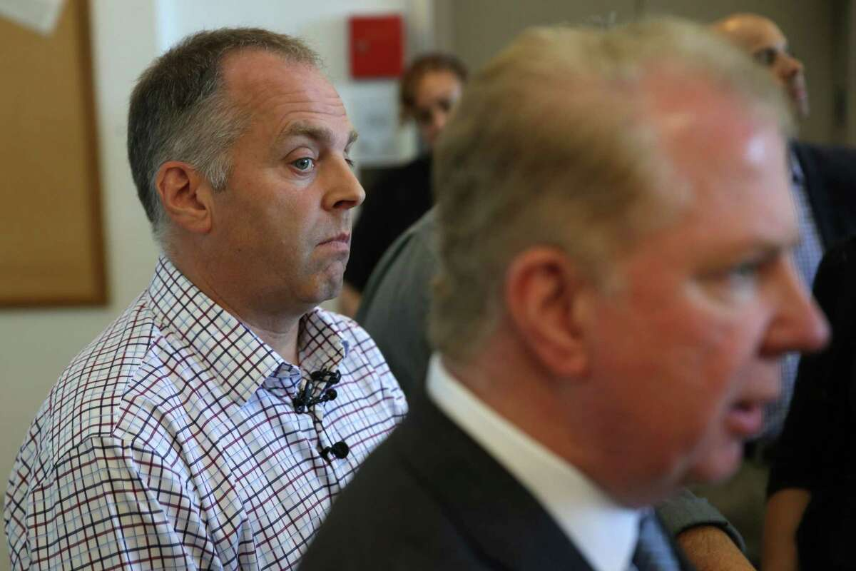 Mayor Ed Murray (right) and director of the Downtown Emergency Services Center Daniel Malone talk to media after touring the new Navigation Center, Tuesday, July 11, 2017. Following in San Francisco's footsteps, this week Seattle opens it's first Navigation Center, an innovative homeless shelter that will allow couples to stay together, guest to have pets, store their belongings and have access to 24-hour services. The shelter will also be low-barrier, meaning that residents are not required to maintain sobriety.