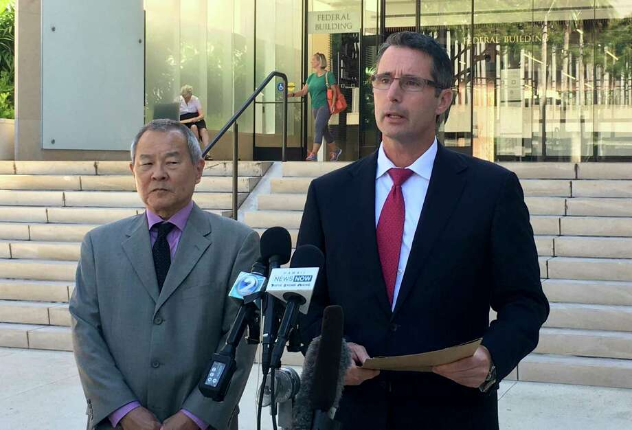 "Paul Delacourt, the FBI special agent in charge of the Hawaii bureau, right, speaks at a news conference as Acting United States Attorney Elliot Enoki, left, listens outside federal court in Honolulu, Monday, July 10, 2017. An active duty soldier based in Hawaii pledged his allegiance to the Islamic State group, helped purchase a drone for it to use against American forces and said he wanted to use his rifle to ""kill a bunch of people,"" according to an FBI affidavit. Ikaika Kang, a sergeant first class in the U.S. Army, made an initial appearance Monday in federal court in Honolulu. He was arrested Saturday on terrorism charges. (AP Photo/Caleb Jones) Photo: Caleb Jones, STF / Copyright 2017 The Associated Press. All rights reserved."
