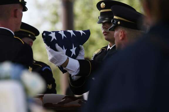 The honor guard prepares the U.S. flag for presentation to family members during burial services for U.S. Army Cpl. Frank Luna Sandoval at Fort Sam Houston National Cemetery, Tuesday, July 11, 2017. Sandoval was missing action and presumed dead since the Korean War. Sandoval was 20-years-old when he was take as a prisoner of war and died of malnutrition. Sandoval was reported missing in action on Feb. 13, 1951 and declared dead over two and a half years later. He body was returned to U.S. custody in 1954 and he was buried as an unknown soldier in Hawaii for decades. The family was notified of his identification early this year.