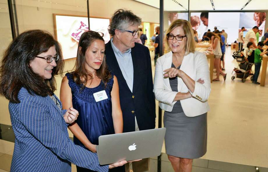 Executive director Janet Carmosky, left, board member and founder Annmarie Lanesey, Workforce Development Institute's Ed Murphy and Lois Johnson during Albany Can Code's first anniversary event at the Apple store at Crossgates Mall Tuesday July 11, 2017 in Guilderland, NY.  (John Carl D'Annibale / Times Union) Photo: John Carl D'Annibale / 40041018A
