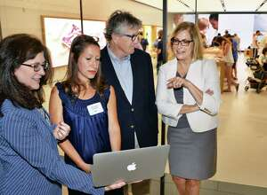 Executive director Janet Carmosky, left, board member and founder Annmarie Lanesey, Workforce Development Institute's Ed Murphy and Lois Johnson during Albany Can Code's first anniversary event at the Apple store at Crossgates Mall Tuesday July 11, 2017 in Guilderland, NY.  (John Carl D'Annibale / Times Union)