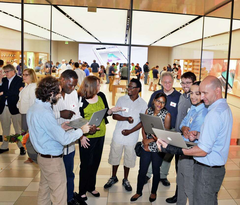 Students and mentors network during Albany Can Code's first anniversary event at the Apple store at Crossgates Mall Tuesday July 11, 2017 in Guilderland, NY. (John Carl D'Annibale / Times Union)