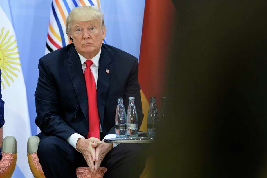 """President Donald Trump attends a panel discussion titled """"Launch Event Women's Entrepreneur Finance Initiative"""" at the G20 summit in Hamburg, Germany. (Photo by Ukas Michael - Pool/Getty Images) Photo: Pool / 2017 Getty Images"""