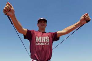 Magnolia starting pitcher Jordan Groshans (4) warms up before a Region III-5A bi-district playoff series at the Mumford Athletic Complex, Saturday, May 6, 2017, in Mumford. Cedar Park defeated Magnolia 6-5 in eight innings to force Game 3.