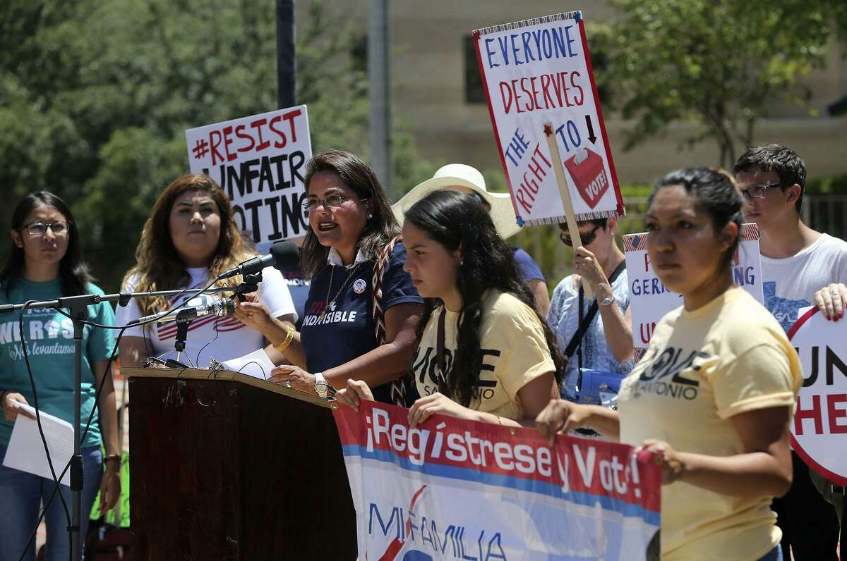 Protesters brave the heat Monday July 10, 2017 outside of the John H. Wood, Jr. Federal Courthouse during a demonstration about suppression of the minority vote due to the redrawing of districts. A trial beginning Monday in San Antonioto to determine the constitutionality of Texas' 2013 redistricting maps is expected to set the stage for changes to state and congressional districts ahead of the 2018 election.