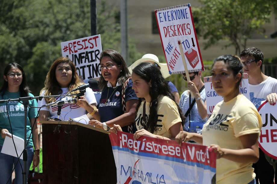 Protesters brave the heat Monday July 10, 2017 outside of the John H. Wood, Jr. Federal Courthouse during a demonstration about suppression of the minority vote due to the redrawing of districts. A trial beginning Monday in San Antonioto to determine the constitutionality of Texas' 2013 redistricting maps is expected to set the stage for changes to state and congressional districts ahead of the 2018 election. Photo: JOHN DAVENPORT, STAFF / San Antonio Express-News / ©John Davenport/San Antonio Express-News