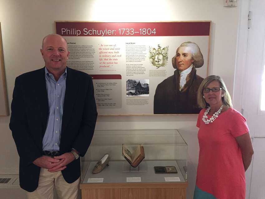 David Hayes and Heidi Hill look over the newly updated displays at the Schuyler Mansion's visitors center, which has drawn record crowds due to the popularity of the smash Broadway musical