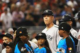 MIAMI, FL - JULY 11: Aaron Judge #99 of the New York Yankees and the American League looks on during the 88th MLB All-Star Game at Marlins Park on July 11, 2017 in Miami, Florida.  (Photo by Mike Ehrmann/Getty Images)