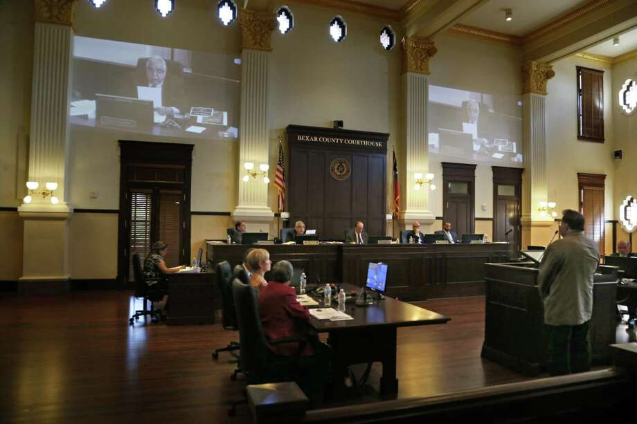 Commissioner Paul Elizondo addresses the court as Jim Cisneros listens,on right.   His brother was a awarded the Texas Legislative Medal of honor. The Bexar County Comissioner's Court gathered on Tuesday for a meeting during which they will address the installation of plaques on the Courthouse grounds honoring the recipients of the Texas Legislative Medal of Honor with ties to Bexar County and South Texas on Tuesday, July 11, 2017 Photo: Ron Cortes, Freelance / For The San Antonio Express-News / Ronald Cortes / Freelance