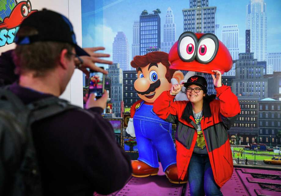 Vanessa Lassesom celebrates the preview of the hybrid home and mobile video game console, Nintendo Switch. Photo: Gabrielle Lurie, Staff / ONLINE_YES