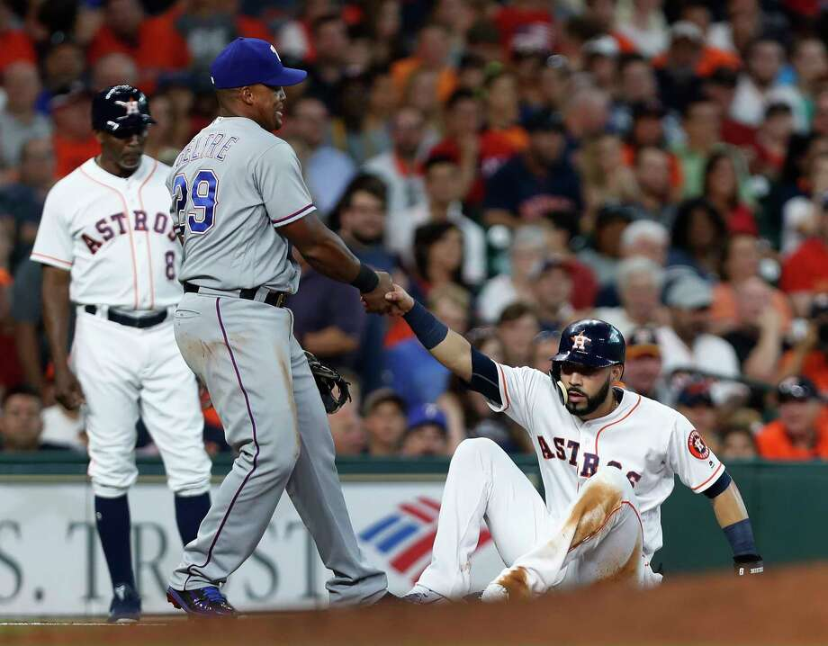 Adrian Beltre may be willing to give Marwin Gonzalez a helping hand, but the rivalry with the Rangers is becoming more intense, thanks to the Astros' move to the AL. Photo: Karen Warren, Staff Photographer / 2017 Houston Chronicle