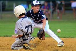 Westport shortstop Ethan Cukier receives the ball at second as Fairfield National's Charlie Swanson slides during District 2 little league action at Unity Park  in Trumbull, Conn. on Tuesday July 11, 2017.