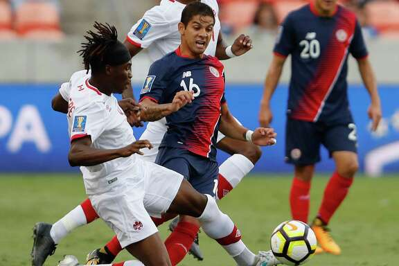 Canada Samuel Adekugbe (4) battles for the ball from Costa Rica Christian Gamboa (16) in the first half during the CONCACAF Gold Cup game between Canada and Costa Rica on Tuesday July 11, 2017.  The game ended in a 1-1 tie.