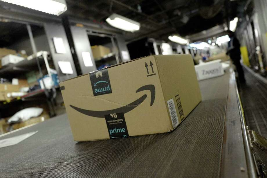 Among Texas-related acquisitions and mergers, the largest this year has been Amazon's purchase of Whole Foods in June $13.4 billion. Photo: Mark Lennihan, STF / AP