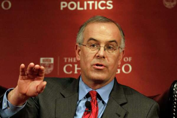 """FILE - In this Jan. 19, 2012, file photo, New York times columnist David Brooks shares a stage with pundits during a panel discussion, """"2012: The Path to the Presidency"""", at the University of Chicago in Chicago. Brooks has become a target of online criticism over an opinion piece published July 11, 2017,  in which he describes taking a friend without a college degree to a Mexican restaurant because he assumed she was intimidated by the menu at a gourmet eatery. (AP Photo/Nam Y. Huh, File) ORG XMIT: PAPM105"""
