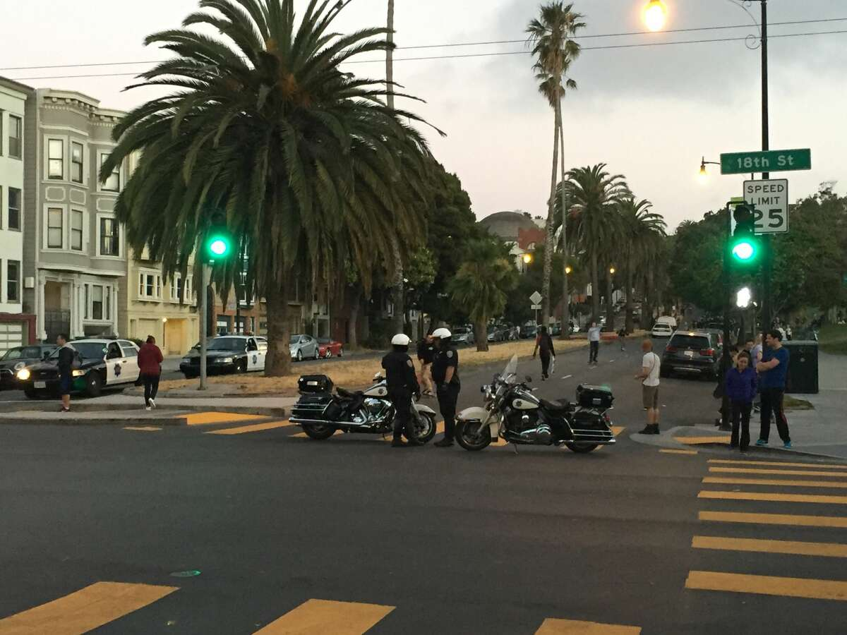 Police are present at Dolores Park after a group of people gathered to skate on July 11, 2017.
