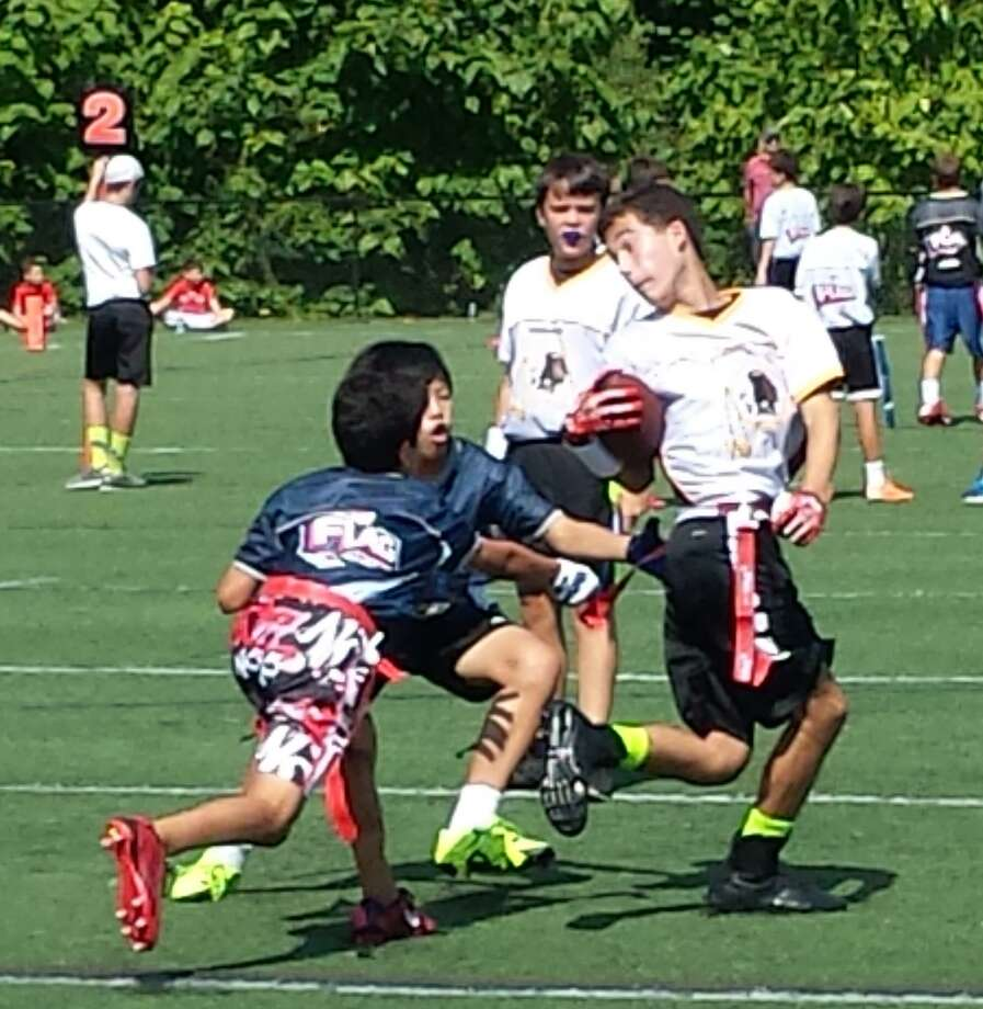 The New Canaan Flag Football League has opened registration for the 2017 season. Photo: Contributed Photo / New Canaan News contributed