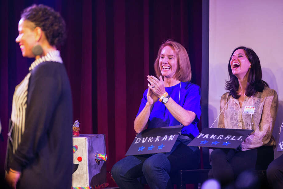 Candidates Jenny Durkan and Jessyn Farrell laugh with Nikkita Oliver to one of her responses during the mayoral race Candidate Survivor 2017 at Neumos on Tuesday, July 11, 2017. Photo: GRANT HINDSLEY, SEATTLEPI.COM / SEATTLEPI.COM