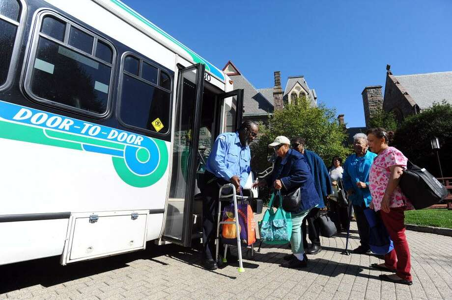 Members of the Over 60 Club board a bus outside the St. John's Episcopal Church in downtown Stamford, Conn. on Wednesday, Oct. 5, 2016. The cost of a single ticket fare with rise from $3 to $3.20 and a book of ten from $24 to $28 and will cost the club thousands more each year. Photo: Michael Cummo / Hearst Connecticut Media / Stamford Advocate