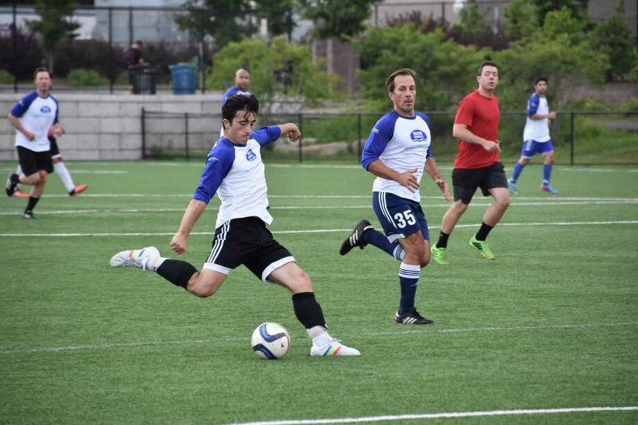 Soccer teams from Nestlé Waters North America and UBS faced off on Tuesday night at Cos Cob Park on Sound Shore Drive in Greenwich to raise money for Stamford Dollars for Scholars. Photo: Nestlé Waters North America
