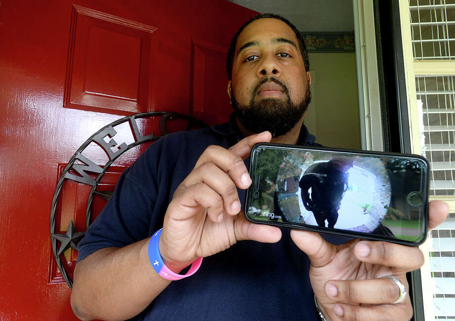 Andrae Thierry is among those using alternative, DIY-style home security, such as a doorbell camera that is viewable on his cell phone. Recently, he called the police, who were also recorded upon arrival at his home's entry as seen here, after getting a video alert of a suspicious person attempting to open his door while he was at work. Photo taken Tuesday, July, 11, 2017 Kim Brent/The Enterprise Photo: Kim Brent / BEN