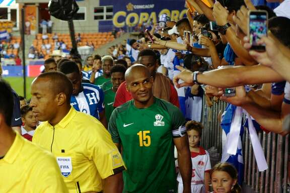 HOUSTON , TX - JULY 11:  Florent Malouda of French Guiana #15 leads his country out onto the pitch prior to the 2017 CONCACAF Gold Cup Group A match between Honduras and French Guiana at BBVA Compass Stadium on July 11, 2017 in Houston, Texas.  (Photo by Matthew Ashton - AMA/Getty Images)